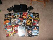 Playstation 2 w/ two controllers and 21 games