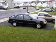 2000 Mazda Protege,  black,  sunroof & spoiler